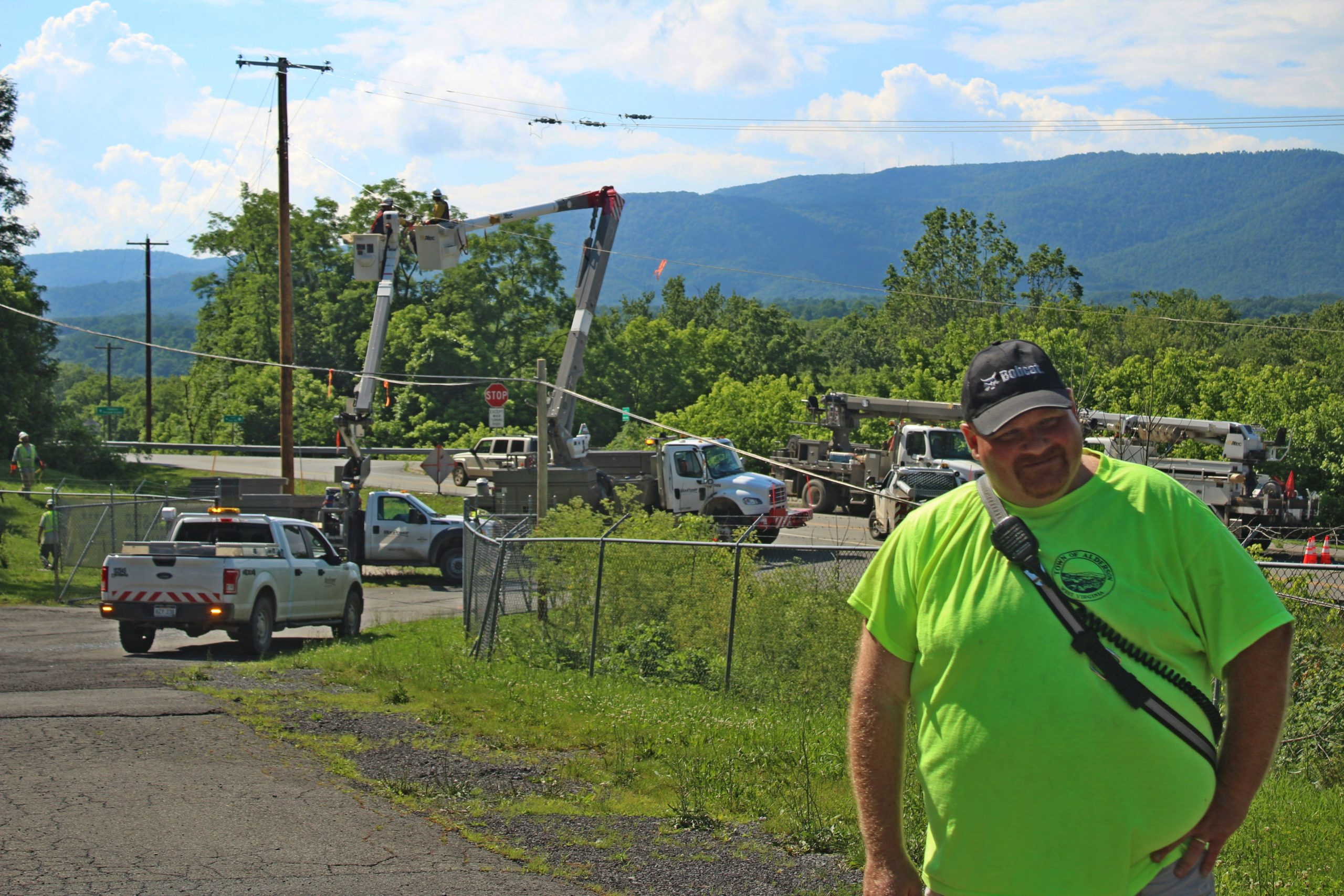 """The guys behind us are some of the heroes,"" said Alderson Mayor Travis Copenhaver (right). ""Monroe and Greenbrier DOH has worked feverishly to try to take care of the slides and the power company, First Energy, has been here since yesterday. I reached out to their governmental liaison and those guys were mobilize immediately. The infrastructure teams have been doing everything that they can and it's great."""